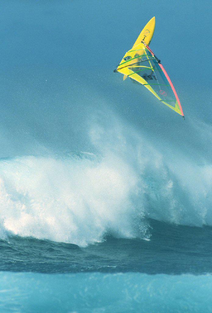 Hawaii, Maui, Ho´okipa, Alex Aguera airborne over huge wave, : Stock Photo