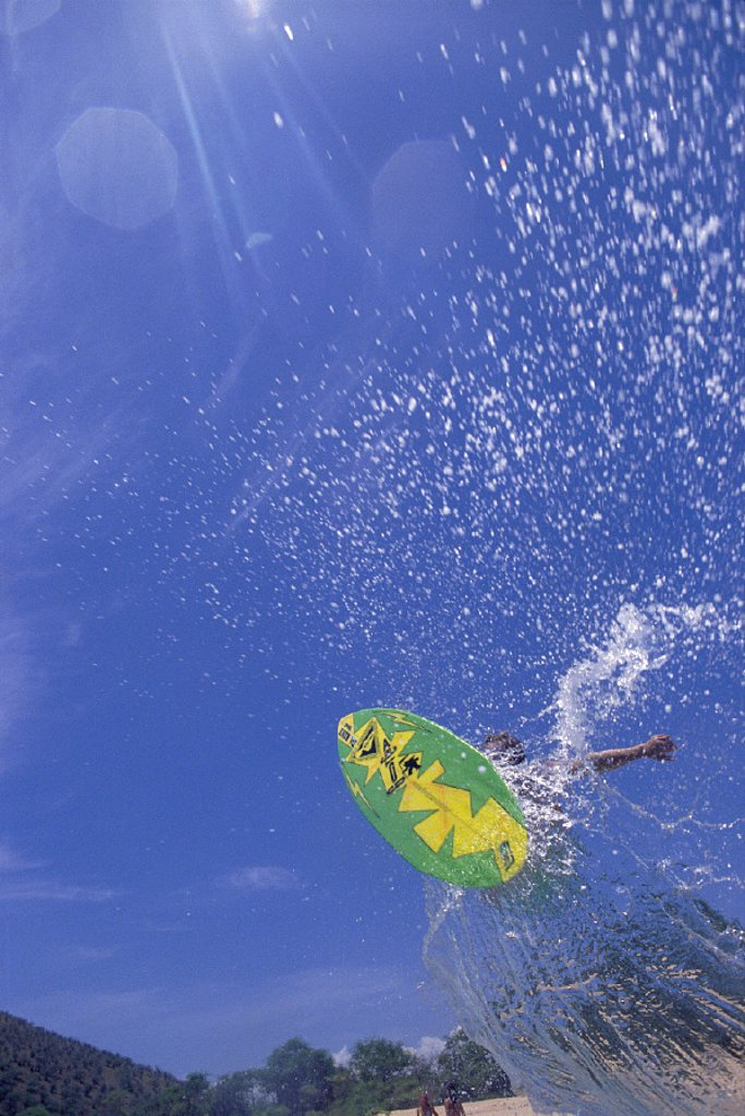 Hawaii Maui Makena upward vu person on skimboard vertical to ocean D1250 splash blue sky Big Beach : Stock Photo