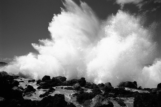 Hawaii, Maui, Makena Coast, Huge surf crashing along lava rock shoreline Black and white photograph : Stock Photo