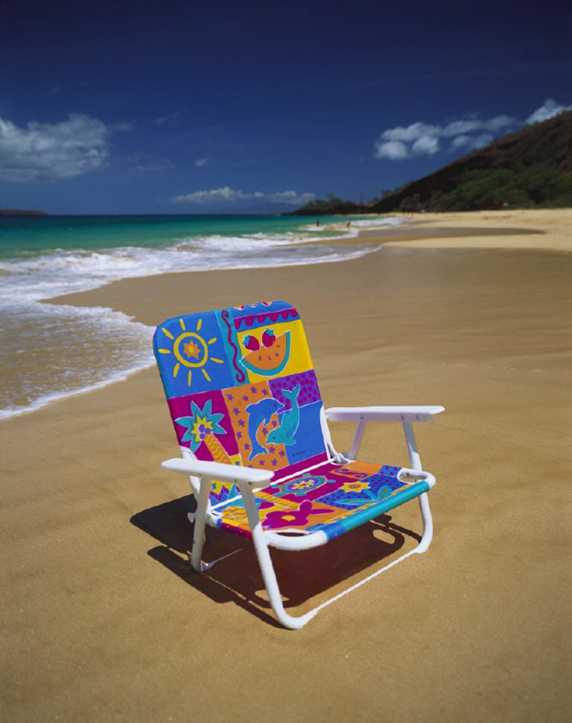 Hawaii, Maui, Makena State Park, Big Beach, colorful beach chair on beach with calm waves washing ashore turquoise water : Stock Photo
