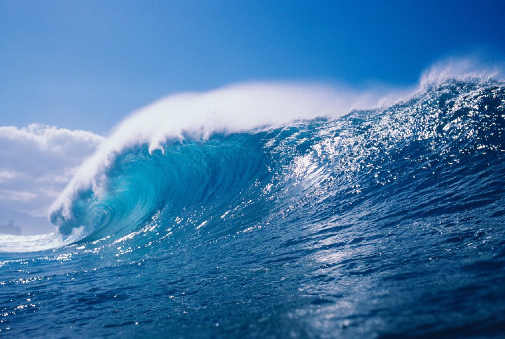 Stock Photo: 1760-2289 View of large, glassy wave, with blue sky in background