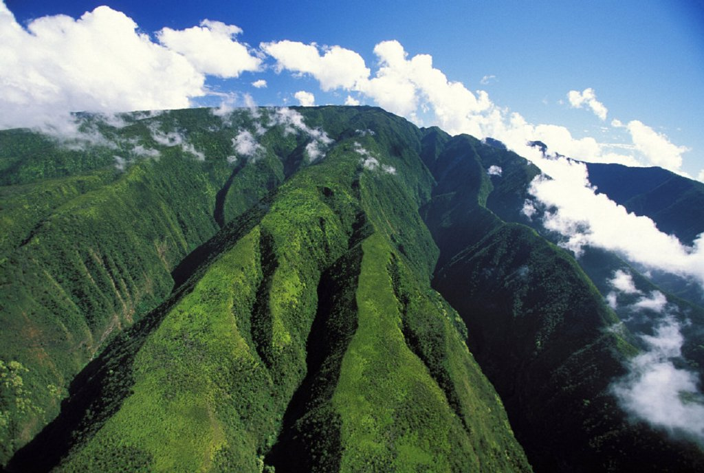 Hawaii, Maui, Crevices descending from Pu´u Kukui, Clouds in sky : Stock Photo