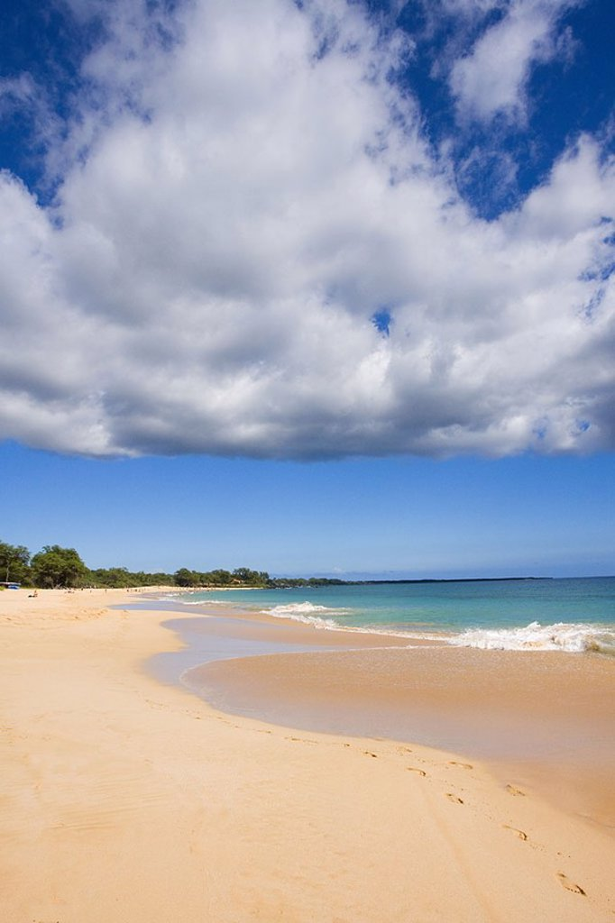 Hawaii, Maui, Makena State Park, Oneloa or Big Beach, water lapping onto shore of warm sandy beach : Stock Photo