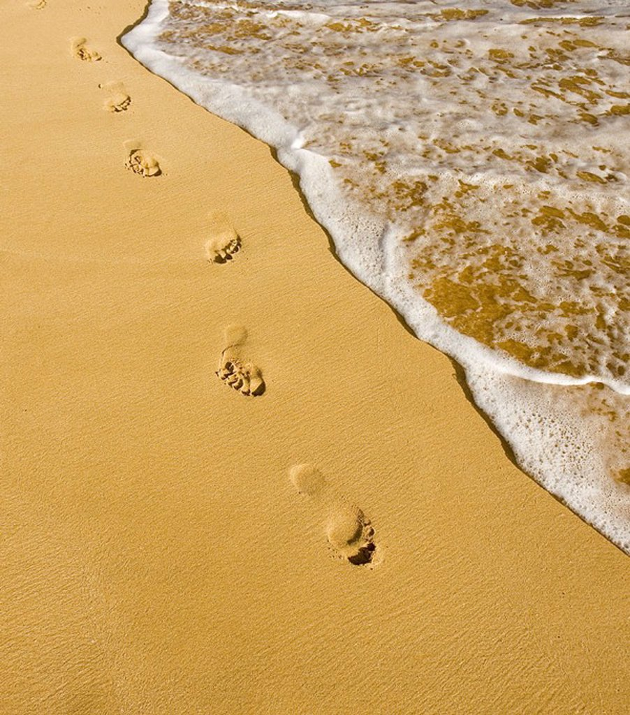 Stock Photo: 1760-25099 Hawaii, Maui, Makena State Park, Oneloa or Big Beach, Footprints in the sand along the ocean, golden light
