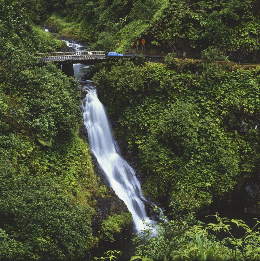 Hawaii, Maui, Waterfall beneath bridge on way to Hana. : Stock Photo