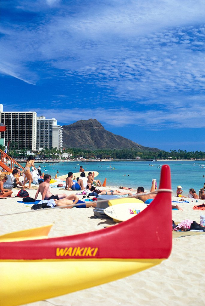 Stock Photo: 1760-2598 Closeup of an outrigger and people Waikiki beach, white sand, Diamond Head in C1557 bkgd