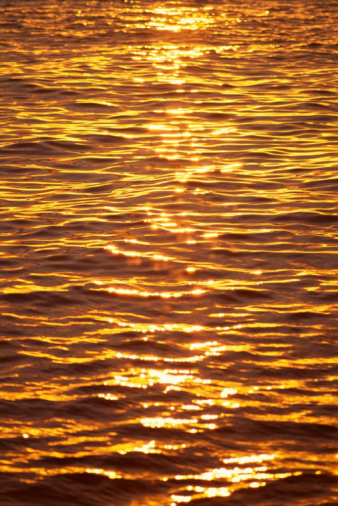 Ocean texture ripples at sunset, golden yellow waters B1447 : Stock Photo