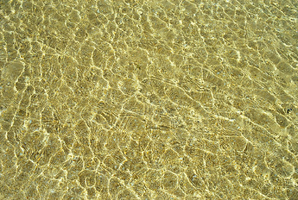 Stock Photo: 1760-2759 Water reflections and sand  B1476