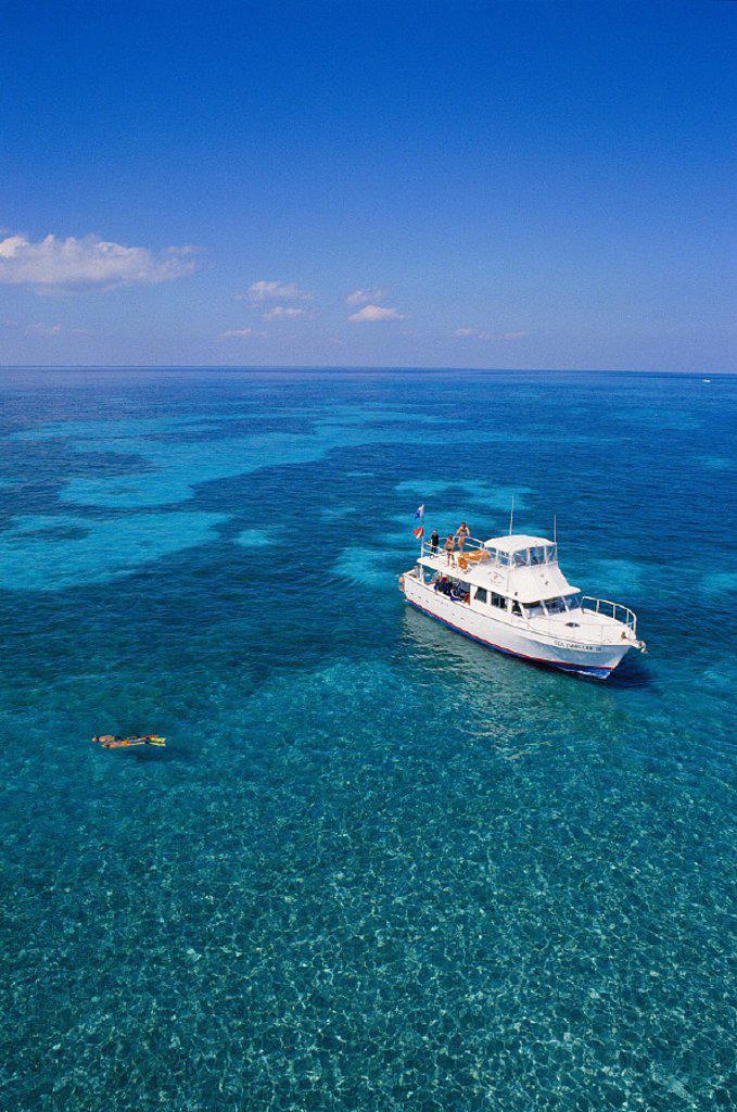Stock Photo: 1760-28903 Florida vu fr above snorkeler couple and boat off Molasses Reef Key Largo Atlantic Ocean