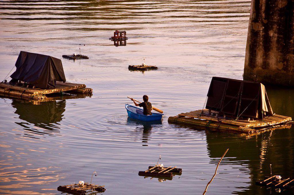 Stock Photo: 1760-30802 Thailand, Kanchanaburi, Lone fisherman under the infamous bridge over the river Kwae.