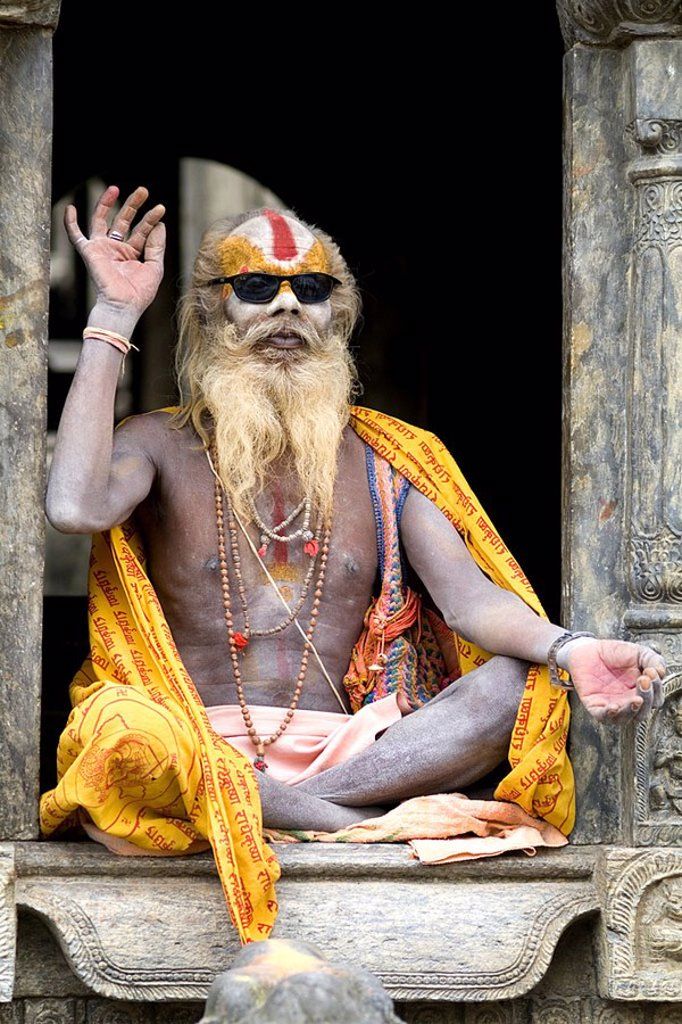 Stock Photo: 1760-31829 Nepal, Kathmandu, painted religious man wearing western sunglasses at Pashupatinath holy Hindu place on Bagmati River