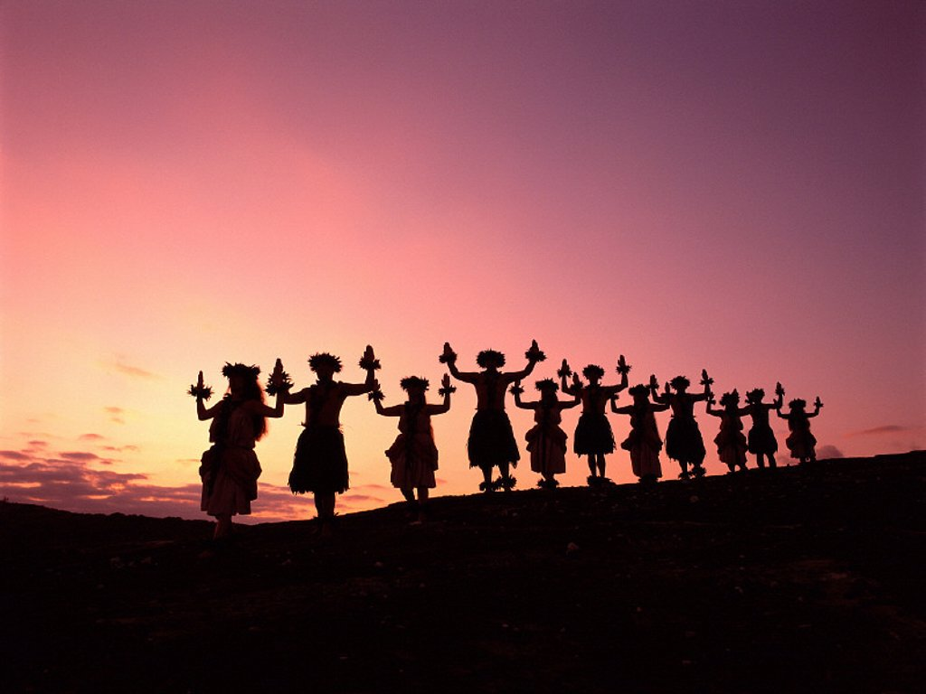 Hawaii, Hula halau posing w/ arms up, standing in row, silhouetted at sunset A36A : Stock Photo