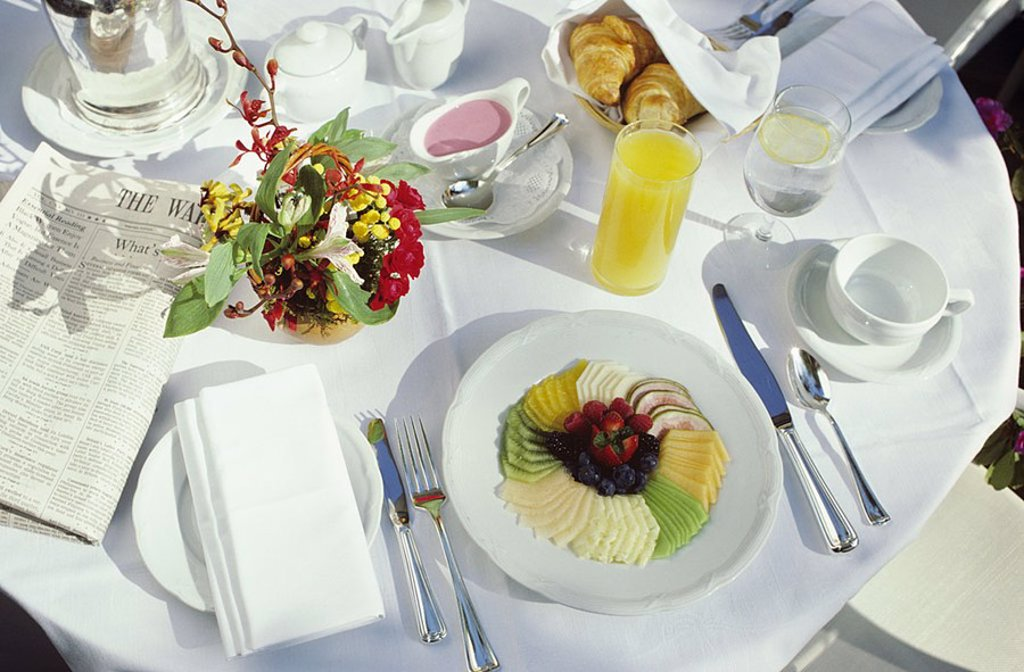 California, Los Angeles, Hotel Bel-Air, Breakfast on patio, Detail of meal on clean white table : Stock Photo