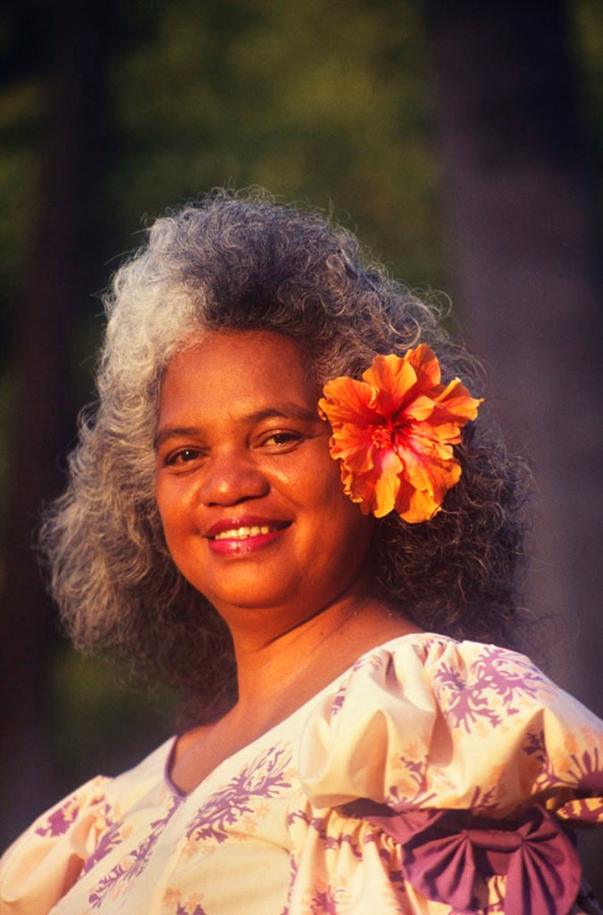 Stock Photo: 1760-3402 Portrait of pure Hawaiian woman in muumuu, smiling with hibiscus in her hair