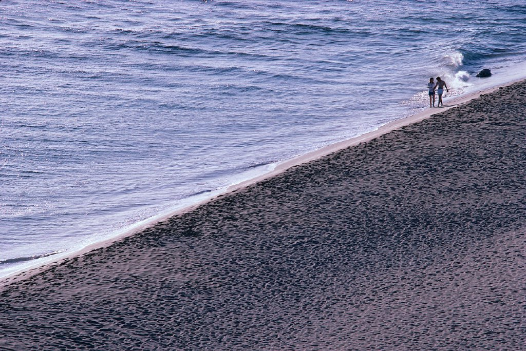 Hawaii Maui, Kaanapali Beach Couple walks along shoreline in distance A06E : Stock Photo
