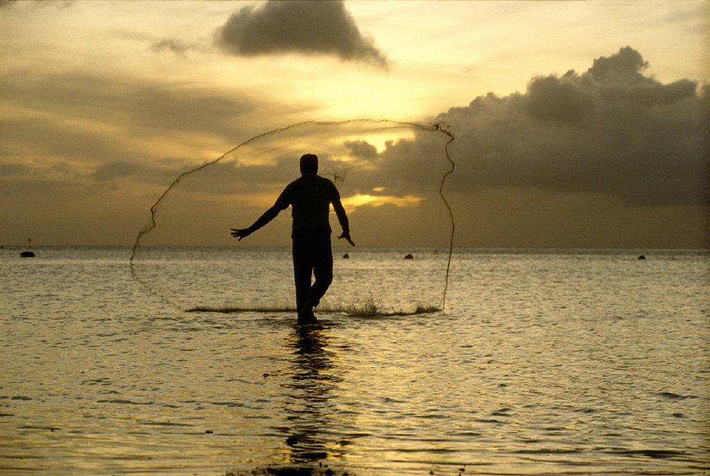 Stock Photo: 1760-5508 N Mariana, Saipan, Fisherman with throw net at sunset B1709