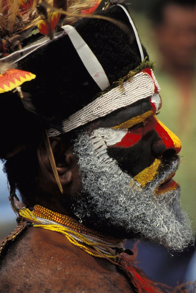 Stock Photo: 1760-5579 Papua New Guinea, profile portrait of man in tribal dress NO MODEL RELEASE