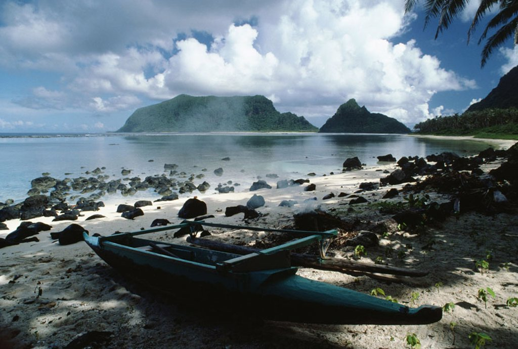 Stock Photo: 1760-5596 American Samoa, Manu´a Island, still beach, canoe docked near smoldering fire