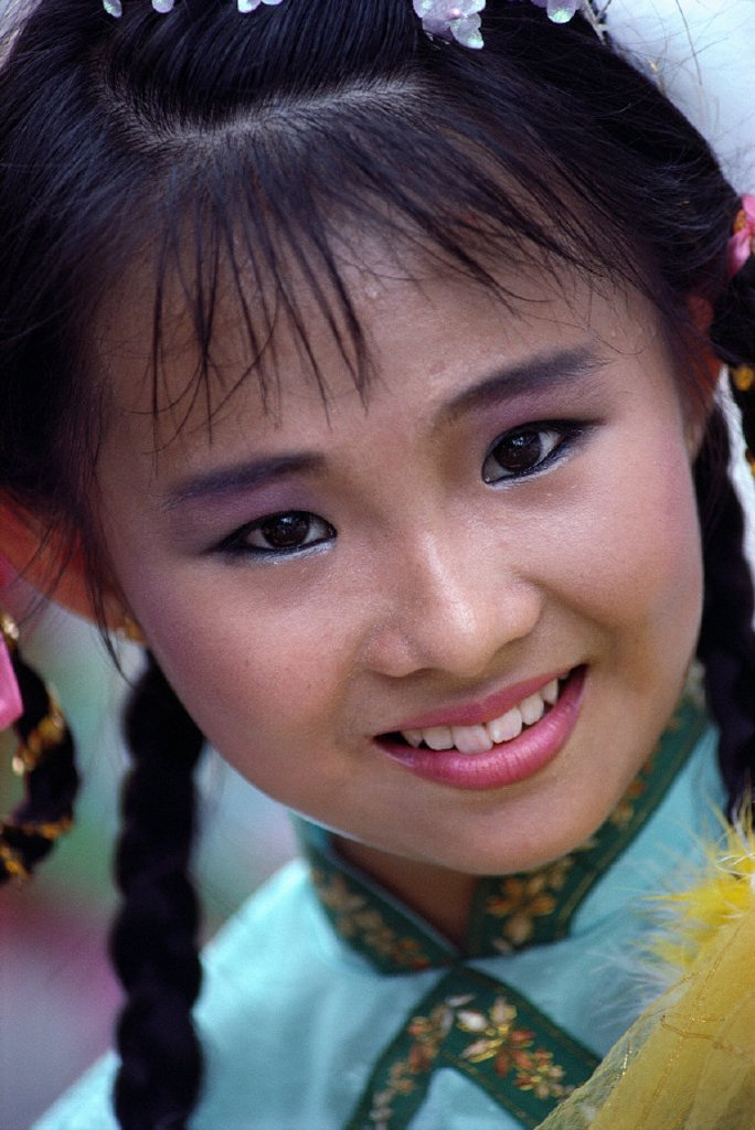 Stock Photo: 1760-5810 Singapore, Oriental girl with Chinese style dress, closeup portrait A71F