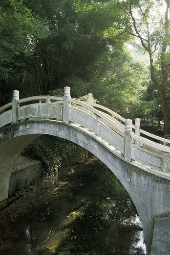 China, Guilin, Seven Star Park, Bridge over stream : Stock Photo