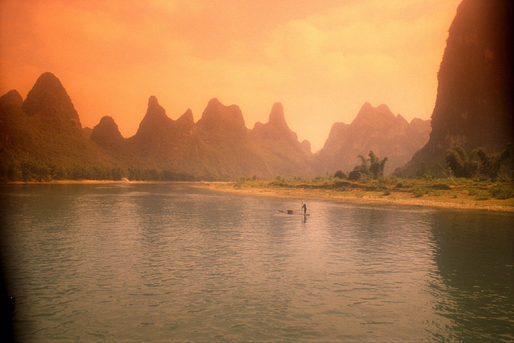 China, Limestone Mountains along Li River orange hues, Guilin C1855 : Stock Photo