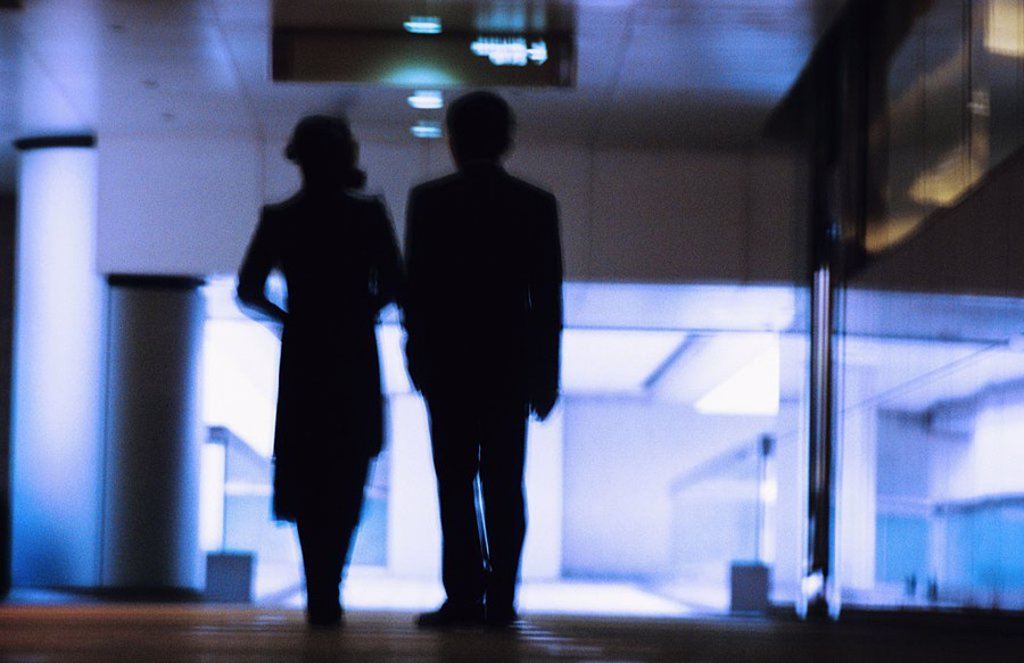 Stock Photo: 1760-5948 Hong Kong, Chinese couple silhouetted in building hallway, Blurred motion