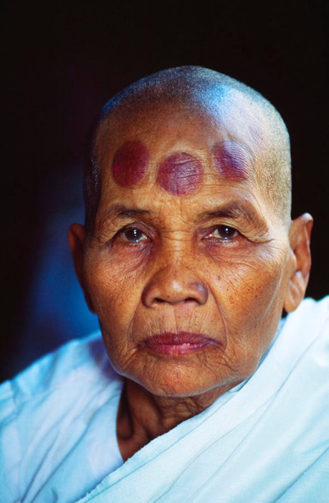 Stock Photo: 1760-5968 Cambodia, Angkor Thom, Bayon temple, Portrait of a female monk with tatoos.