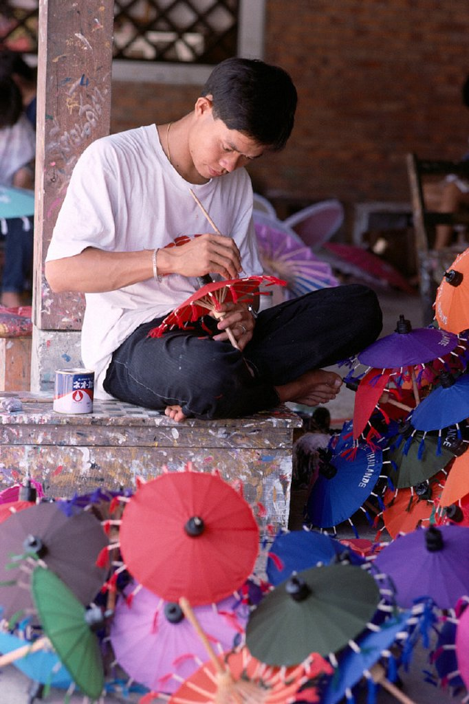 Stock Photo: 1760-5994 Thailand, Bor Sang, Umbrella maker local man handpainting mini - umbrellas, color A76A