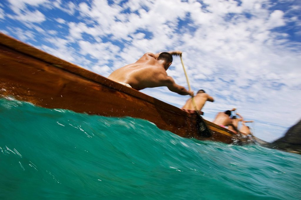 Stock Photo: 1760-6364 Hawaii, Oahu, Waimanalo, Male outrigger canoe team paddling hard through blue-green ocean