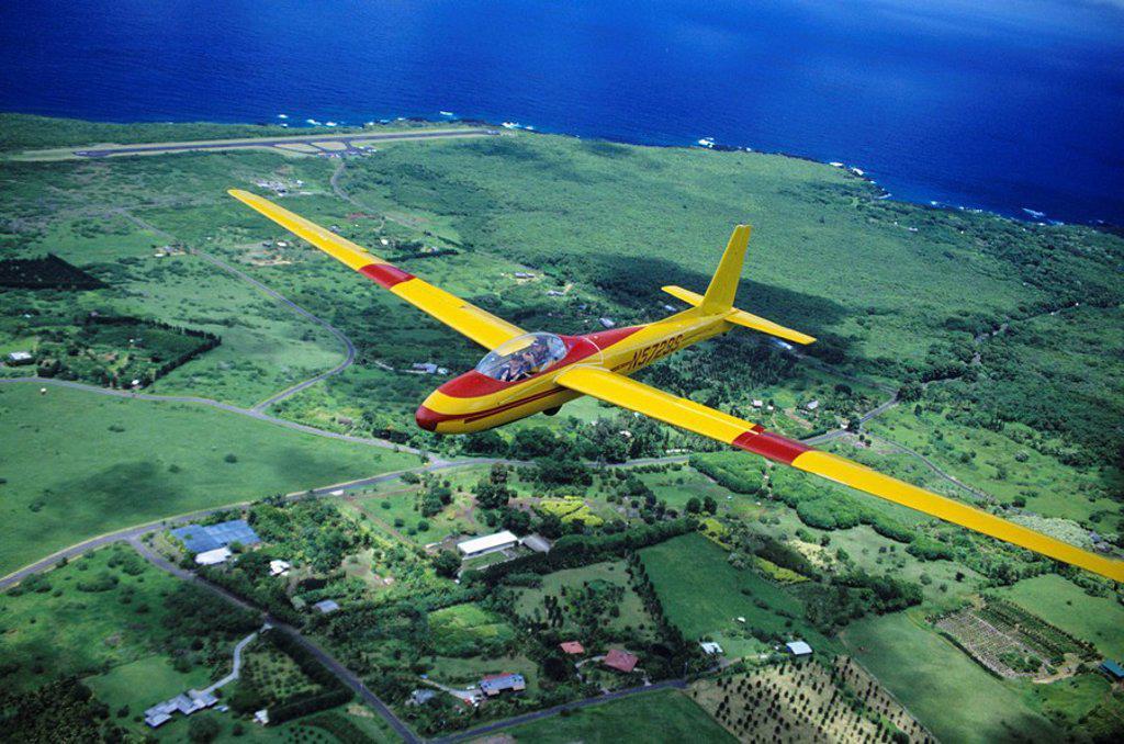 Hawaii, Maui, closeup of yellow glider over Hana, aerial view : Stock Photo