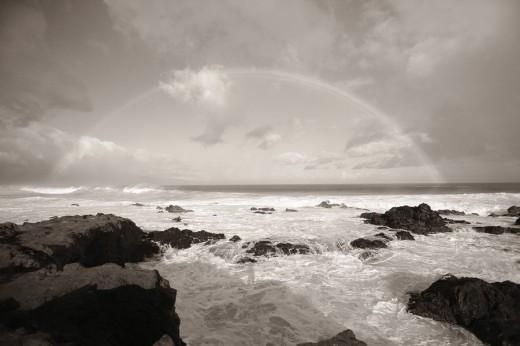 Hawaii, Maui, Rainbow offshore over Hookipa Beach Sepia photograph : Stock Photo
