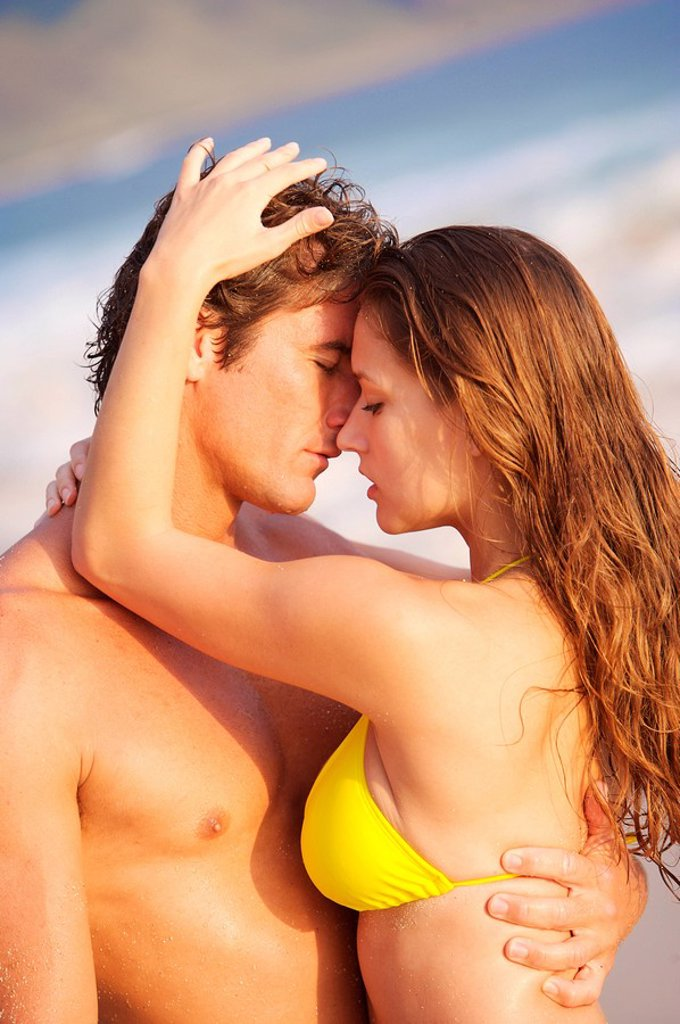 Stock Photo: 1760-6949 Hawaii, Oahu, Sexy couple share a romantic moment at the beach