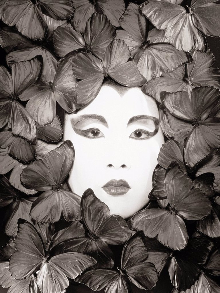 Stock Photo: 1760-7014 Asian woman, Painted white face surrounded by butterflies Sepia photograph