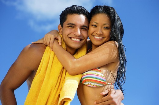 Hawaii, Oahu, Couple posing at the beach. : Stock Photo