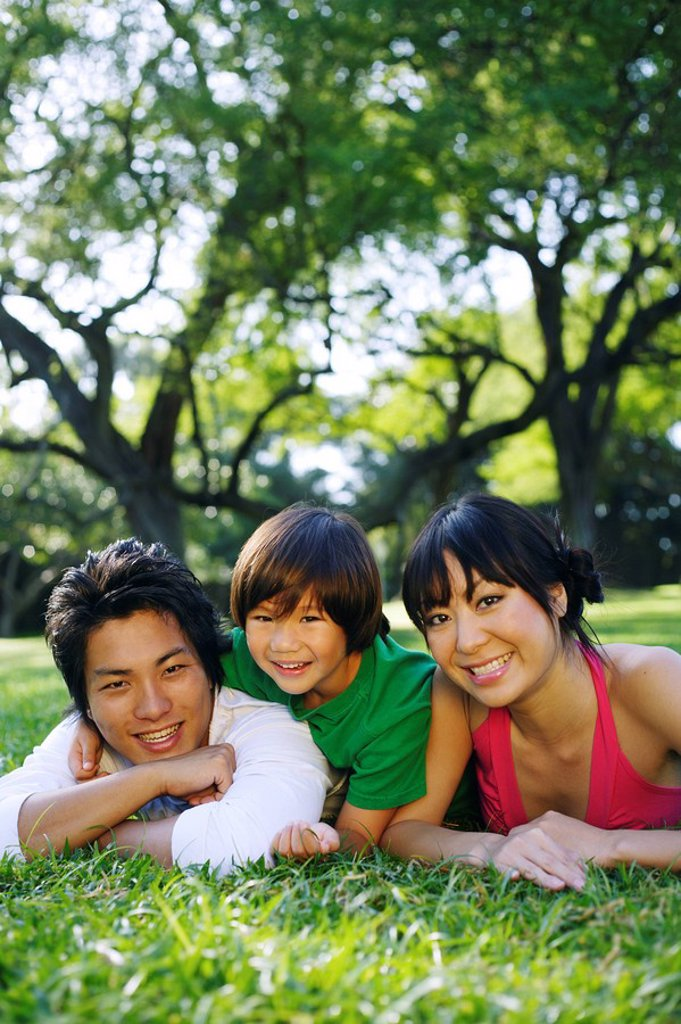 Young Japanese family posing together. : Stock Photo