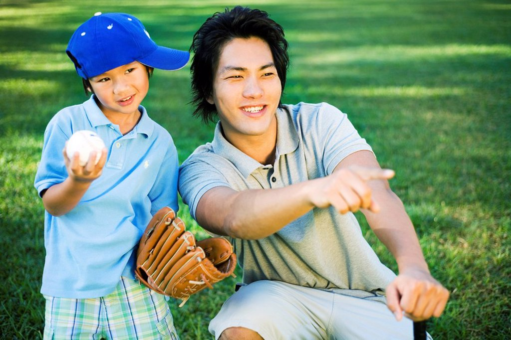 Young Japanese father and child playing baseball. : Stock Photo