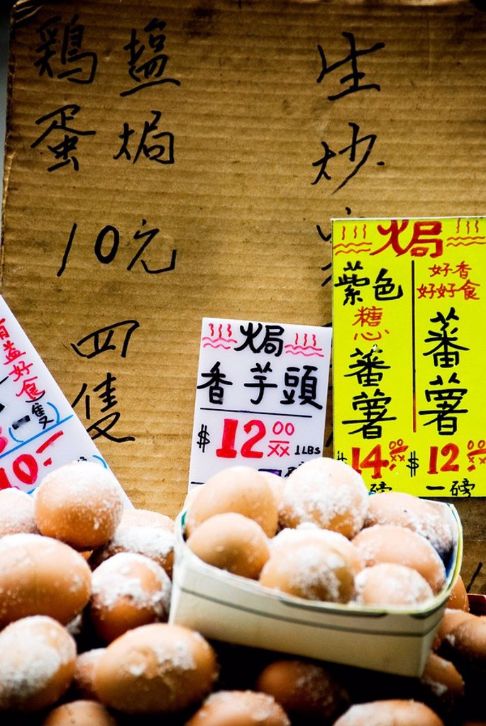 Stock Photo: 1760-8539 Hong Kong, Mong Kok K, Aged eggs for sale along Shantung Street.