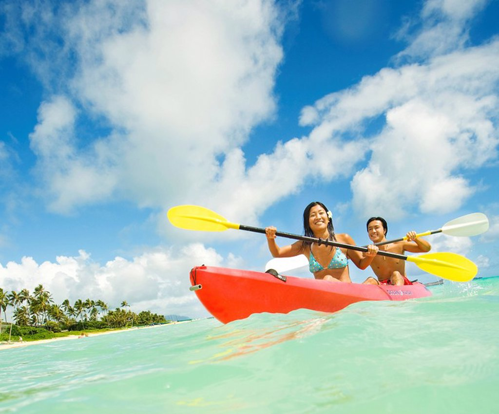 Hawaii, Oahu, Lanikai, Japanese couple kayaking in the ocean. : Stock Photo