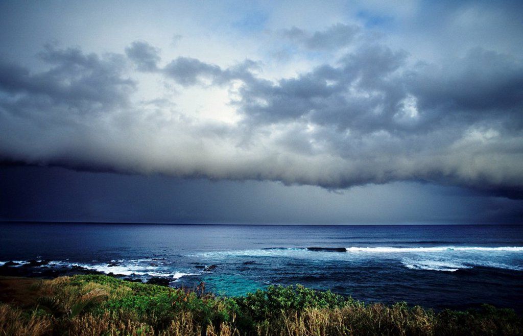 Stock Photo: 1760-9431 Hawaii, Maui, North Shore, Storm front clouds overlooking ocean from hillside.