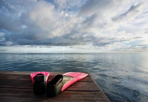 Stock Photo: 1760-9739 Hawaii, Pink fins on dock at sunset.