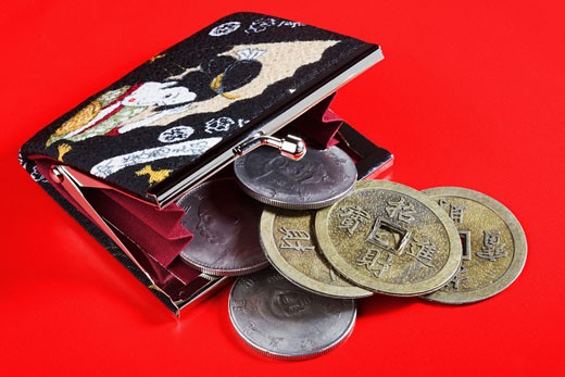 Stock Photo: 1768R-10948 Chinese coins spilling out of a purse