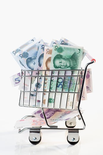 Stock Photo: 1768R-11014 Close-up of Chinese currency in a shopping cart