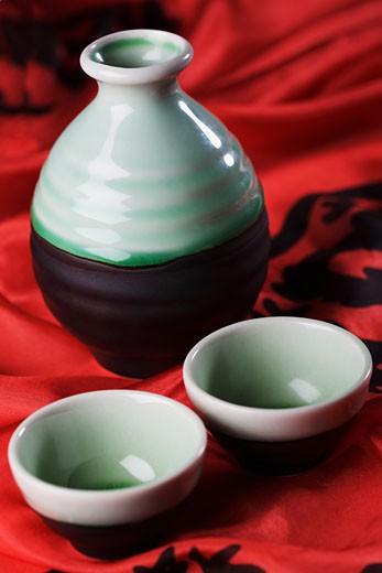 Close-up of two bowls with a jar : Stock Photo
