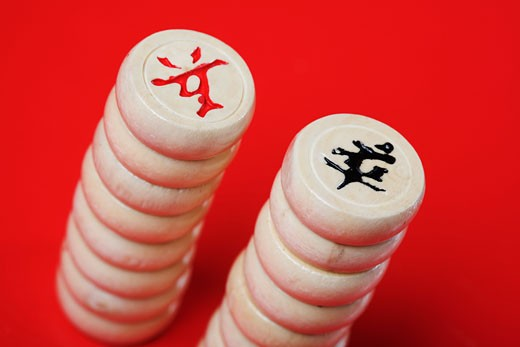 Close-up of stacks of Chinese chess pieces : Stock Photo