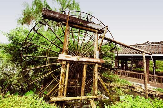 Watermill in a field, Yangshuo, Guangxi Province, China : Stock Photo