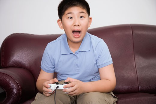 Stock Photo: 1768R-11804 Boy playing video game