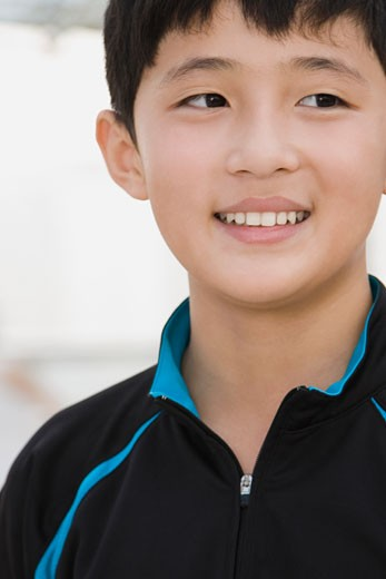 Close-up of a teenage boy smiling : Stock Photo