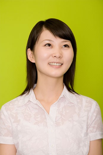 Close-up of a female office worker smiling : Stock Photo