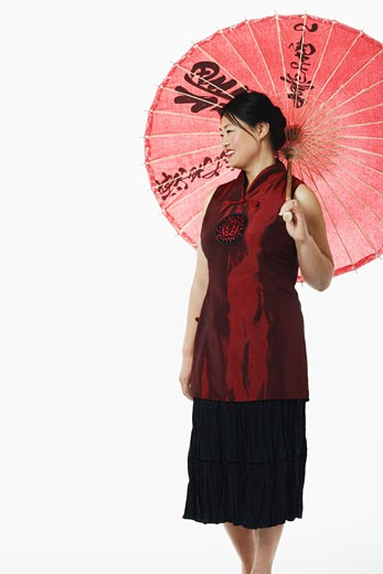 Stock Photo: 1768R-1329 Mid adult woman holding a parasol