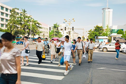 Group of people crossing the road, Hefei, Anhui Province, China : Stock Photo